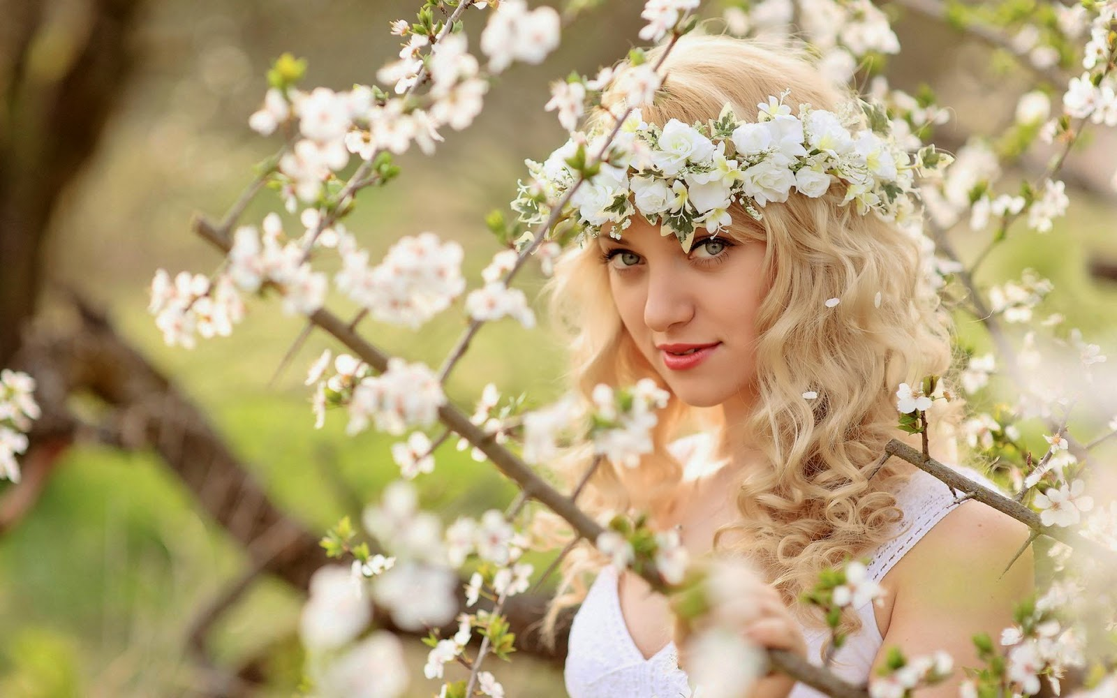 http://uupload.ir/files/lt29_beautiful-girls-with-flowers-crown-on-head-wallpapers.jpg