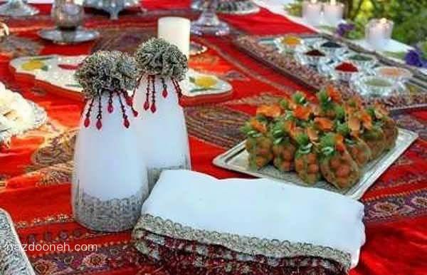 [تصویر: تزیین سفره قندساب(پارچه بالا سر عروس داماد تو روز عقد)]